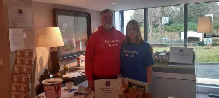 Laura with fellow volunteer Mick at a Christmas raffle
